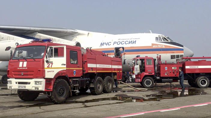 FILE - In this Sunday, June 13, 2021 file photo, this image taken from video provided by Russian Emergency Ministry Sunday, June 13, 2021 shows a IL-76 aircraft loading with water at an airfield in Irkutsk region, Eastern Siberia, Russia. To eliminate the emergency situation associated with forest fires in the Katangsky region, an Il-76 aircraft of the Ministry of Emergencies of Russia arrived in the Irkutsk region. Each year, thousands of wildfires engulf wide swathes of Russia, destroying forests and shrouding broad territories in acrid smoke. This summer has seen particularly massive fires in Yakutia in northeastern Siberia following unprecedented heat. (Russian Emergency Ministry Press Service via AP, File)