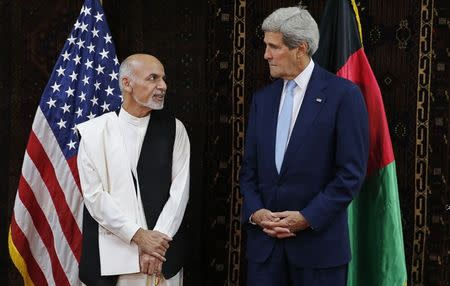 U.S. Secretary of State John Kerry meets Afghanistan's presidential candidate Ashraf Ghani at the U.S. embassy in Kabul