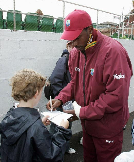 TAUNTON, UNITED KINGDOM - MAY 12:  Chris Gayle of West Indies signs autographs for his fans with his left hand strapped up due to an injury during the West Indies Tour Warm-up match between Somerset CCC v West Indies at The County Ground on May 12, 2007 in Taunton, England.  (Photo by Christopher Lee/Getty Images) *** Local Caption *** Chris Gayle