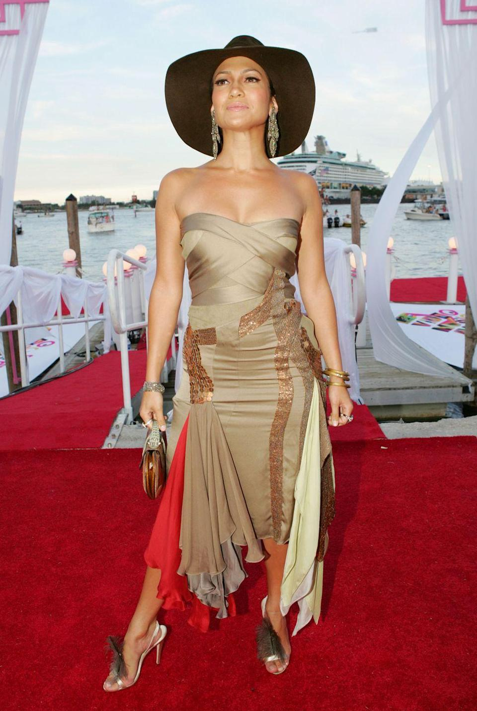 <p>Another red-carpet hat moment, you guys! Here, she pairs it with a strapless bronze dress, strappy heels, and shoulder-grazing earrings at MTV Video Music Awards. </p>