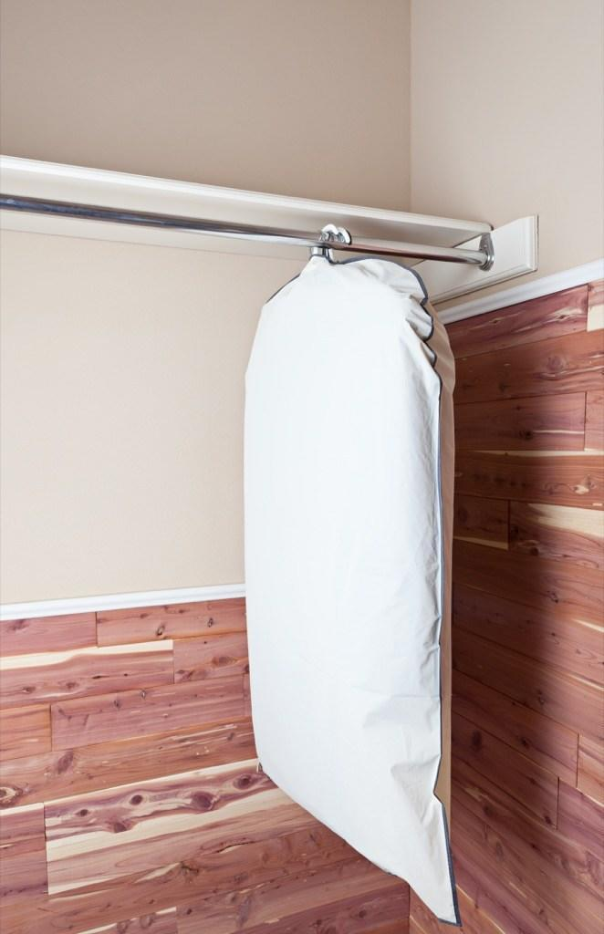 """Wrapping paper is one of the hardest things to store—especially since you only need to use it a handful of different times throughout the year. Instead of trying to shove half-used rolls in a box, get a plastic garment bag. They fit perfectly inside, stay nice and neat, and can be hung up in the back of your closet where they hardly take up any space. And for more organization secrets, see the <a rel=""""nofollow noopener"""" href=""""https://bestlifeonline.com/easy-desk-organize/?utm_source=msn&utm_medium=feed&utm_campaign=msn-feed"""" target=""""_blank"""" data-ylk=""""slk:20 Easy Tips for Keeping Your Desk Organized."""" class=""""link rapid-noclick-resp"""">20 Easy Tips for Keeping Your Desk Organized.</a>"""