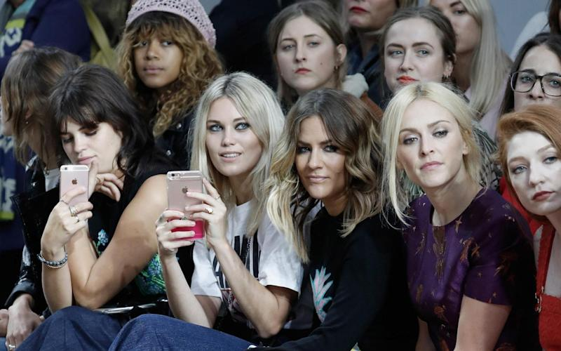 Front row next to the late Caroline Flack - Getty