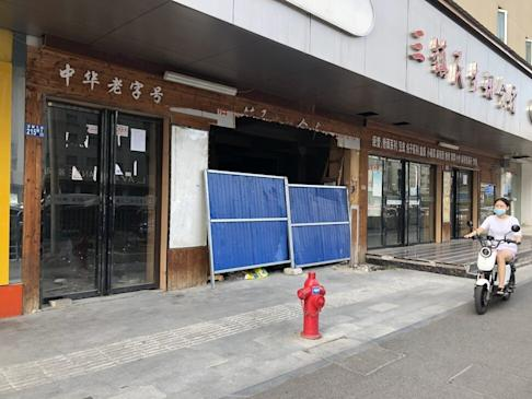 Dozens of stores surrounding the Huanan Seafood Wholesale Market, the initial epicentre of the outbreak, are still closed. Photo: Orange Wang