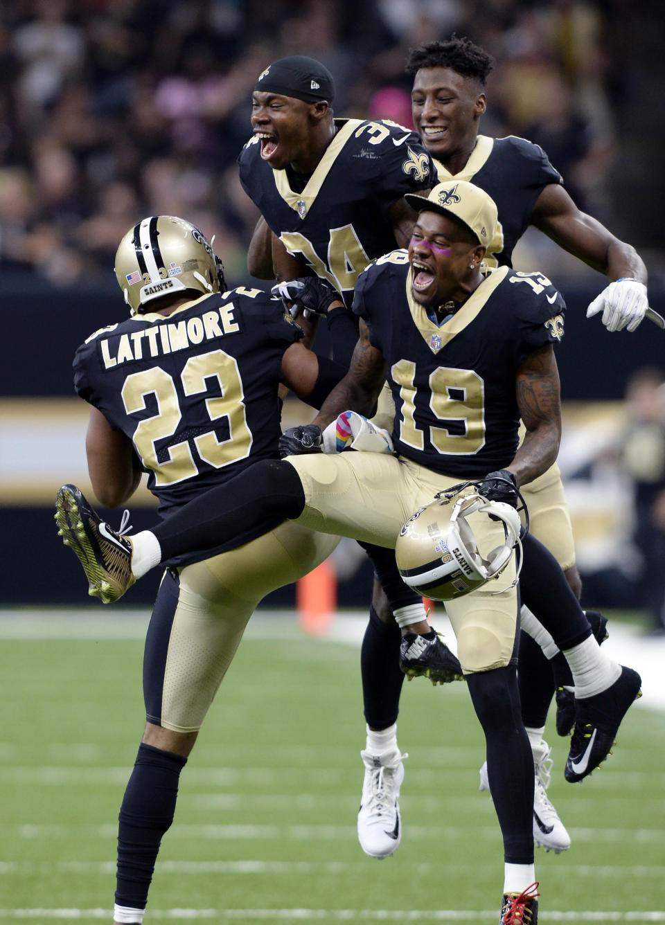 <p>New Orleans Saints cornerback Marshon Lattimore (23) celebrates his interception and touchdown with wide receiver Ted Ginn (19) and defensive back Justin Hardee (34) in the second half of an NFL football game against the Detroit Lions in New Orleans, Sunday, Oct. 15, 2017. (AP Photo/Bill Feig) </p>