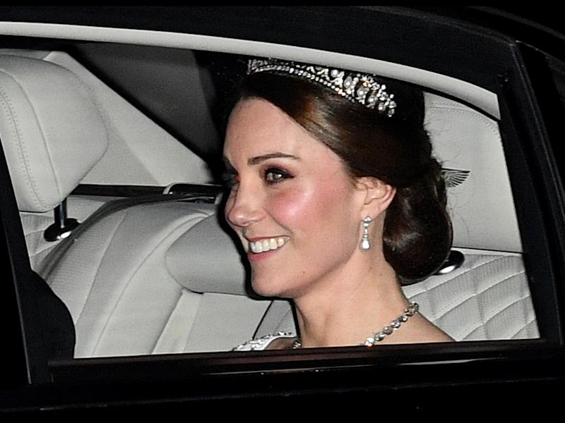 The royal stepped out to an even with her husband Prince William while wearing his late mother's tiara and a bridal white outfit.