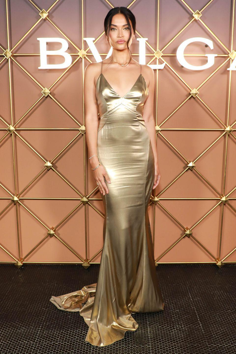 <p><strong>8 September</strong></p><p>Shanina Shaik posed in a liquid gold gown. </p>