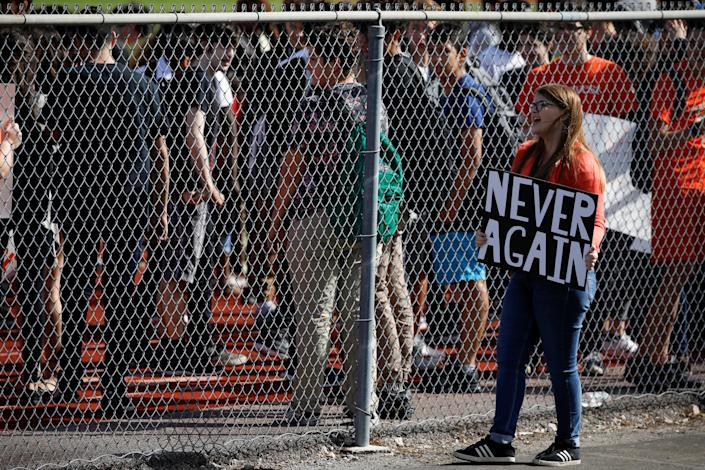 <p>Students from Western High School carrying placards, take part in a protest in support of the gun control, following a mass shooting at Marjory Stoneman Douglas High School, in Davie, Fla., Feb. 21, 2018. (Photo: Carlos Garcia Rawlins/Reuters) </p>