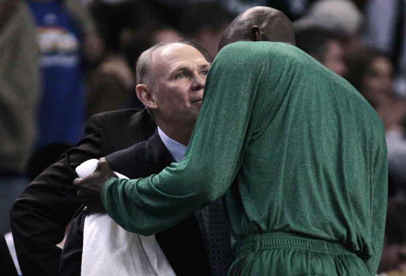 Boston Celtics forward Kevin Garnett, right, embraces Denver Nuggets coach George Karl after an NBA basketball game in Boston, Wednesday, Dec. 8, 2010. The Celtics beat the Nuggets 105-89, holding Karl's win record at 999 games. (AP Photo/Charles Krupa)