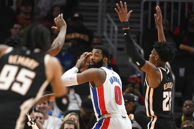 Detroit Pistons center Andre Drummond (0) looks to pass as Atlanta Hawks forward Cam Reddish, right, defends during the first half of an NBA basketball game Saturday, Jan. 18, 2020, in Atlanta. (AP Photo/John Amis)