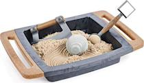 """<p><strong>Kinetic Sand</strong></p><p>amazon.com</p><p><strong>$20.98</strong></p><p><a href=""""https://www.amazon.com/dp/B084BT3266?tag=syn-yahoo-20&ascsubtag=%5Bartid%7C10055.g.34935171%5Bsrc%7Cyahoo-us"""" rel=""""nofollow noopener"""" target=""""_blank"""" data-ylk=""""slk:Shop Now"""" class=""""link rapid-noclick-resp"""">Shop Now</a></p><p>Children have long known how soothing it can be to run sand through your fingers, either on the beach or on a play table. This Zen box was designed for adults. Keep it on your desk, and when work stress gets too overwhelming, you can just roll a rock through the sand or let it slide through your fingers.</p>"""