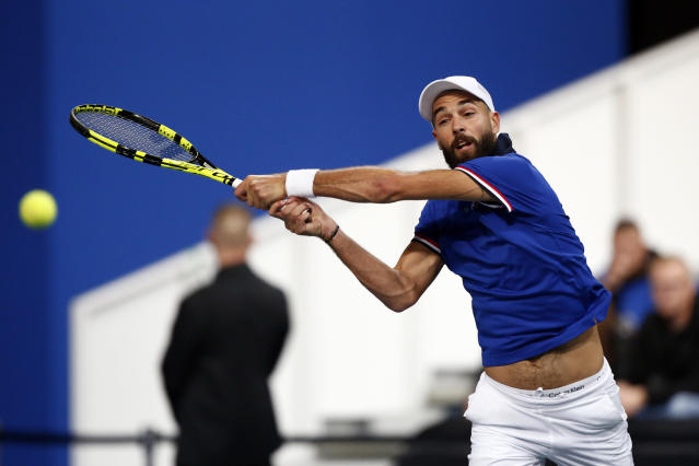 France's Benoit Paire returns the ball to Spain's Pablo Carreno Busta during the Davis Cup semifinals France against Spain, Friday, Sept.14, 2018 in Lille, northern France. (AP Photo/Michel Spingler)