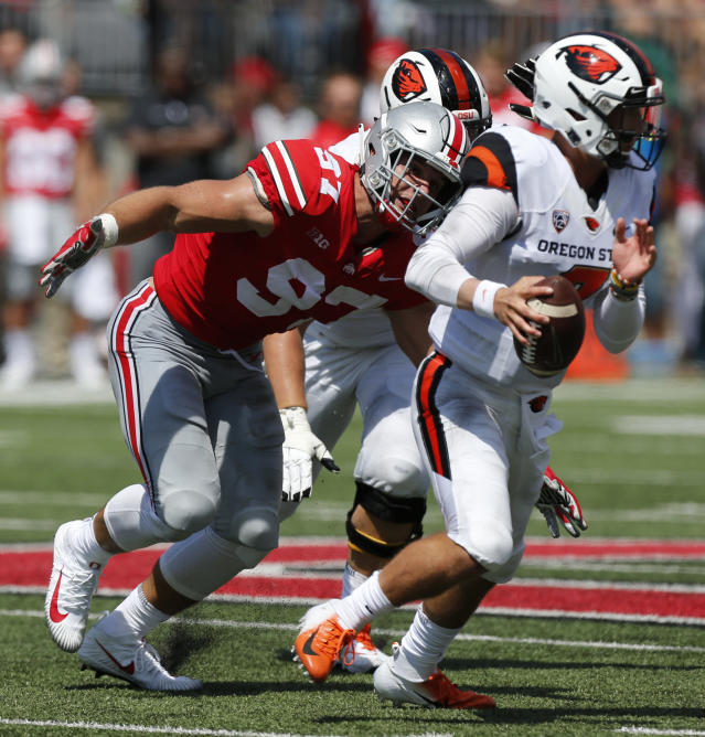 Ohio State defensive lineman Nick Bosa, left, sacks Oregon State quarterback Conor Blount during the first half Sept. 1, 2018, in Columbus, Ohio. (AP Photo/Jay LaPrete)