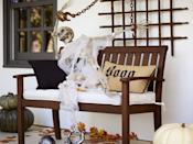 <p>Have a bench on your front porch? Seat a life-size skeleton (the one pictured is from Pottery Barn) there to greet guests as they approach your front door. </p>