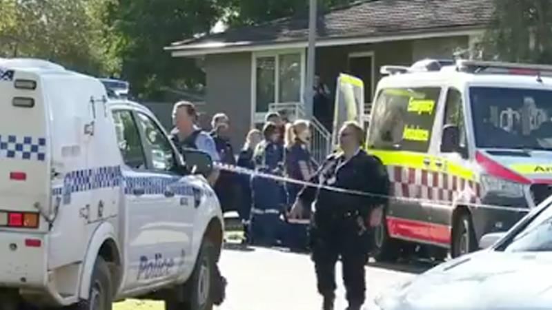 Two people aged in their 20s are dead after a double stabbing at a Bidwill home in Sydney's northwest. Pictured are NSW Police and paramedics at the scene.