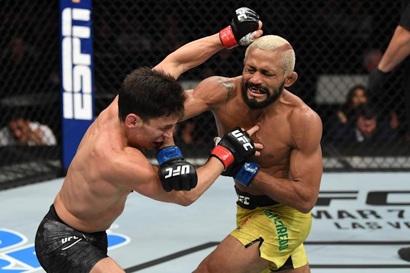NORFOLK, VA - FEBRUARY 29: (R-L) Deiveson Figueiredo punches Joseph Benavidez in their flyweight championship bout during the UFC Fight Night event at Chartway Arena on February 29, 2020 in Norfolk, Virginia. (Photo by Josh Hedges/Zuffa LLC via Getty Images)