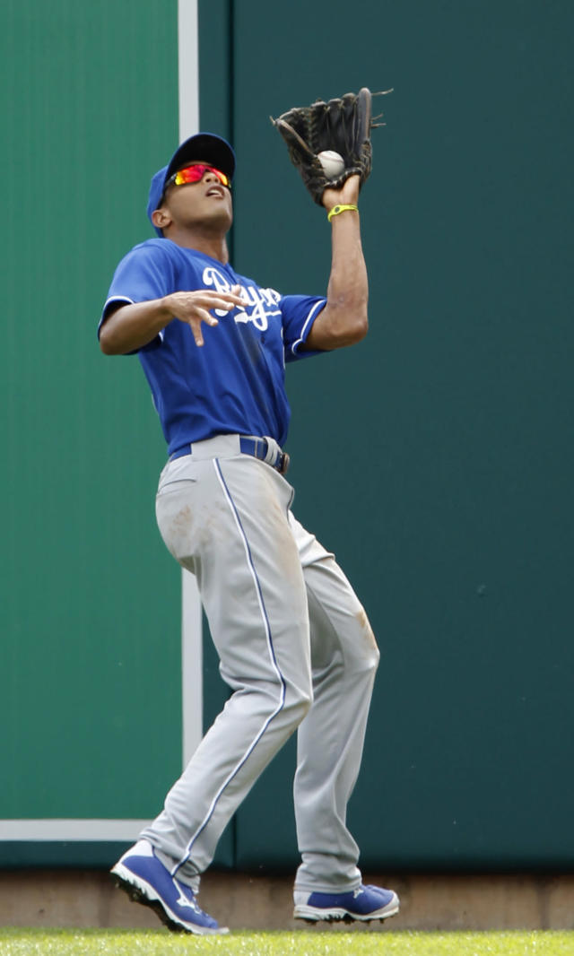 Kansas City Royals right fielder Justin Maxwell catches a fly ball hit by Detroit Tigers' Austin Jackson in the third inning during the first game of a doubleheader baseball game Friday, Aug. 16, 2013, in Detroit. (AP Photo/Duane Burleson)