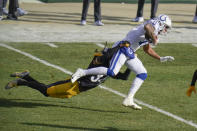 Indianapolis Colts wide receiver Michael Pittman, right, drags Pittsburgh Steelers strong safety Terrell Edmunds, left, after making a catch during the first half of an NFL football game, Sunday, Dec. 27, 2020, in Pittsburgh. (AP Photo/Gene J. Puskar)