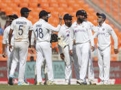 India's captain Virat Kohli, center, gestures to the umpire after watching the replay of England's Ben Foakes' dismissal during the third day of fourth cricket test match between India and England at Narendra Modi Stadium in Ahmedabad, India, Saturday, March 6, 2021. (AP Photo/Aijaz Rahi)