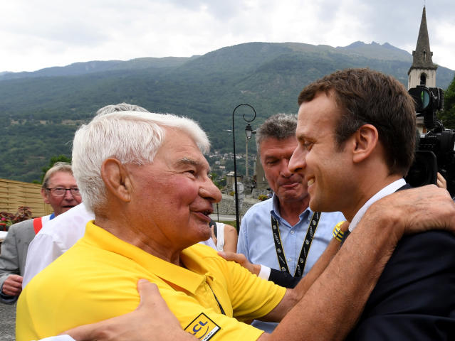 """FILE - In this July 19 2017 file photo, French President Emmanuel Macron speaks with former French cyclist ace Raymond Poulidor , in Saint-Martin-d'Arc, after the e 104th edition of the Tour de France cycling race between Le La Mure and Serre-Chevalier, French Alps. Tour de France organizers have confirmed that former rider Raymond Poulidor, known as """"the eternal runner-up"""" behind five-time winners Jacques Anquetil and Eddy Merckx, has died. He was 83 years old. (Jean-Pierre Clatot, Pool via AP)"""