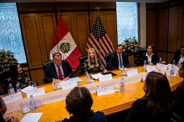 Ivanka Trump attempts to represent women's economic empowerment, while sitting in between men. (Photo: Getty Images)