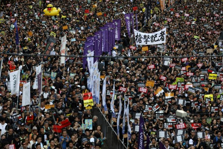 The city has also seen three huge and peaceful rallies (AFP Photo/Dale DE LA REY)