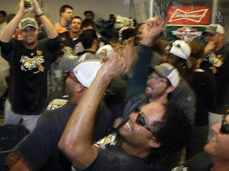 """Oakland Athletics players, including Coco Crisp, bottom center, do the """"Bernie"""" dance in the locker room as they celebrate after clinching a wild card berth in the American League at the end of a baseball game against the Texas Rangers Monday, Oct. 1, 2012, in Oakland, Calif. (AP Photo/Ben Margot)"""