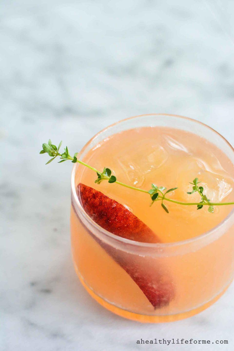 "<p>The most delicious way to get smashed.</p><p>Get the recipe from <a href=""http://ahealthylifeforme.com/peach-bourbon-thyme-smash/"" rel=""nofollow noopener"" target=""_blank"" data-ylk=""slk:A Healthy Life For Me"" class=""link rapid-noclick-resp"">A Healthy Life For Me</a>.</p>"