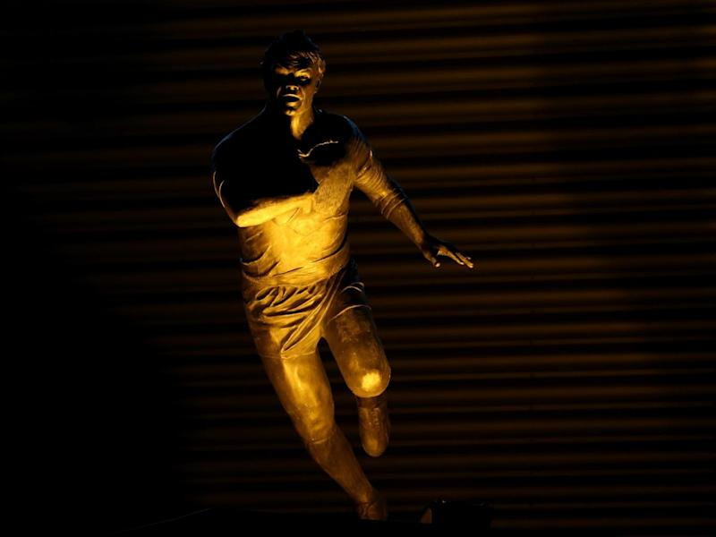 Cunningham is immortalised in a bronze statue outside the ground (Getty)