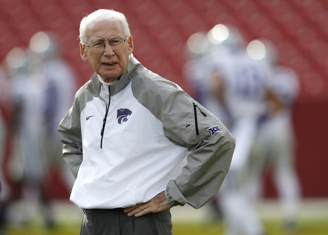 FILE - In this Oct. 29, 2016, file photo, Kansas State coach Bill Snyder stands on the field before the team's NCAA college football game against Iowa State in Ames, Iowa. College athletes will no longer need permission from their coach or school to transfer and receive financial aid from another school. The NCAA Division I Council approved the change Wednesday, June 13, 2018. It takes effect Oct. 15. Standoffs between athletes and coaches over transfers have often led to embarrassing results for schools standing in the way of player who wishes to leave. Last spring at Kansas State, reserve receiver Corey Sutton said he was blocked him from transferring to 35 schools by coach Bill Snyder before the school finally relented after public pressure. (AP Photo/Charlie Neibergall, File)