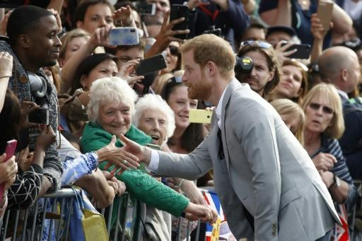 Prince Harry greeted the crowds outside Windsor Castle, where many will spend the night to secure a good spot for Saturday's events