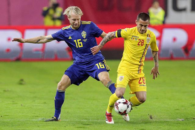Soccer Football - International Friendly - Romania vs Sweden - National Arena, Craiova, Romania - March 27, 2018 Romania's Alexandru Mitrita in action with Sweden's Johan Larsson Inquam Photos/Octav Ganea via REUTERS ROMANIA OUT. NO COMMERCIAL OR EDITORIAL SALES IN ROMANIA THIS IMAGE HAS BEEN SUPPLIED BY A THIRD PARTY. IT IS DISTRIBUTED, EXACTLY AS RECEIVED BY REUTERS, AS A SERVICE TO CLIENTS