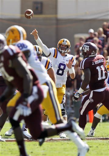 LSU quarterback Zach Mettenberger (8) throws against Texas A&M during the first half of their NCAA college football game, Saturday, Oct. 20, 2012, in College Station, Texas. (AP Photo/Eric Kayne)