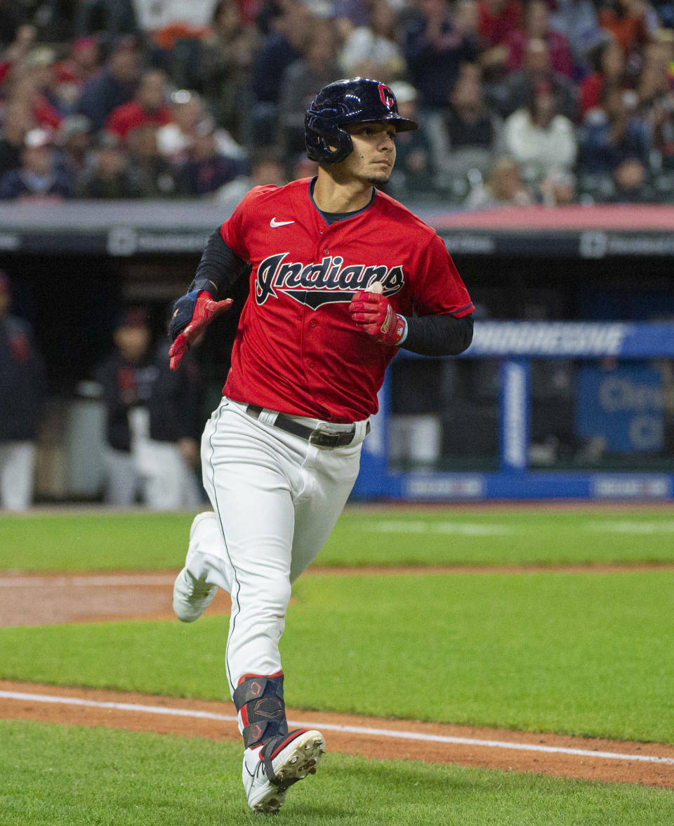 Cleveland Indians' Andres Gimenez heads to first base after hitting a solo home run off Chicago White Sox starting pitcher Lance Lynn during the third inning of a baseball game in Cleveland, Saturday, Sept. 25, 2021. (AP Photo/Phil Long)