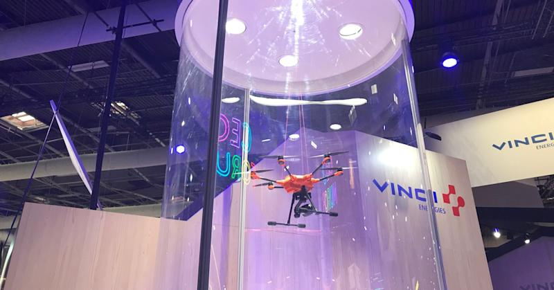 Camera-equipped drones that let you see what they record with a virtual reality headset on display at Viva Tech.