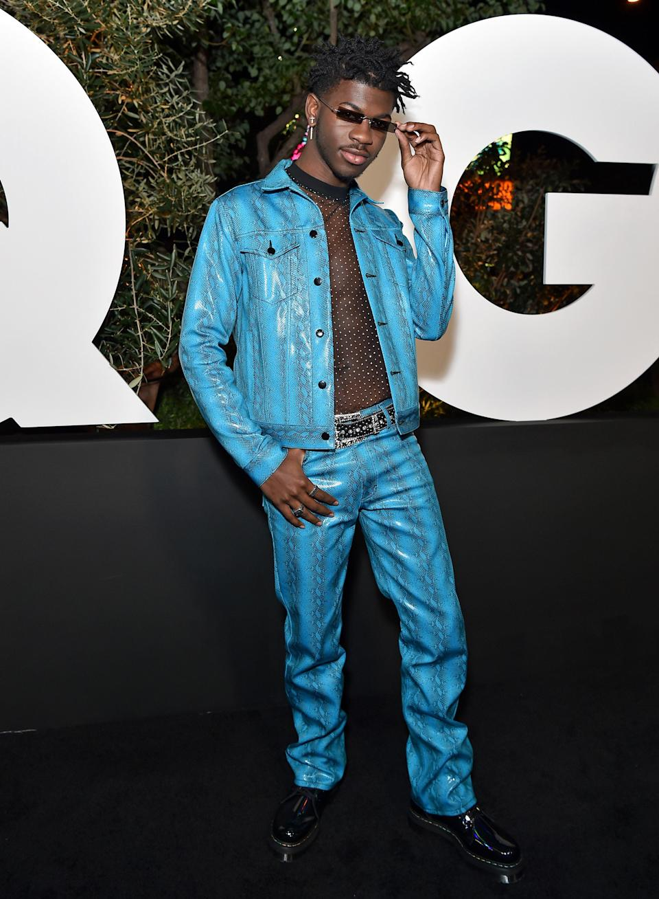 Lil Nas X served us major '00s glam with this full blue snakeskin outfit at 2019 GQ Men of the Year. Extra points for the tiny sunglasses and see-through shirt.
