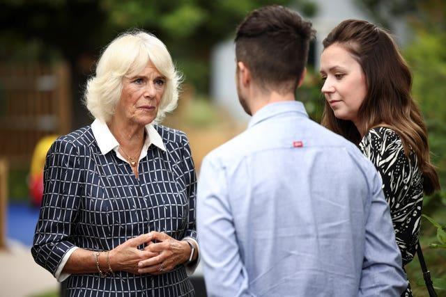 The Duchess of Cornwall meets Zoe and Jake Lynch during a visit to the Helen & Douglas House children's hospice in Oxford