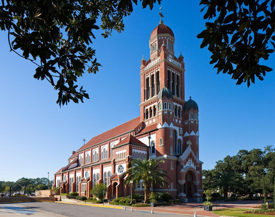 <p><strong>Tell me: What's this place all about?</strong><br> Historic churches and cathedrals are hardly a rarity in this religious part of the world, especially with the Catholic influence that looms so large in Louisiana. This imposing red and white brick cathedral, though, is impressive even within that well-populated arena.</p> <p><strong>What's it like being there?</strong><br> It's a working, living place of worship and so some degree of reverence is both necessary and immediately noticeable. The interior is tranquil and a place for reflection of course, as are equally the cemetery and the beautiful, centuries-old 'Cathedral Oak' tree.</p> <p><strong>Is there a guide involved?</strong><br> There are no regular guided tours on site, but they can easily be arranged by contacting the cathedral through a phone number on their website.</p> <p><strong>Who comes here?</strong><br> The cathedral was busy with its parishioners, praying or visiting the cemetery, as well as day trippers to Lafayette taking in one of it's most architecturally impressive buildings.</p> <p><strong>Did it meet expectations?</strong><br> The cathedral is just a century old and is a memorable example of the Dutch Romanesque Revival Style, the striking red and white brick structure framing historic stained glass windows imported from Germany. The domed interior opens up to reveal a wonderfully-preserved, colorful and airy church.</p> <p><strong>So, then, what, or who, do you think it's best for?</strong><br> It's an obvious stop for fans of historic churches, though anyone wanting some quiet time amid genuinely inspiring architecture will also savor their time here.</p>