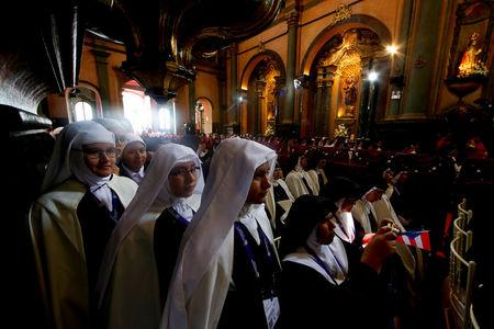 Nuns are pictured as Pope Francis leads a mid-morning prayer with contemplative nuns at the Sanctuary of the Senor de los Milagros in Lima