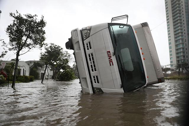 <p><strong>Miami</strong><br> A truck is seen on its side after being blown over as Hurricane Irma passed through on Sept. 10, 2017 in Miami, Fla. (Photo: Joe Raedle/Getty Images) </p>