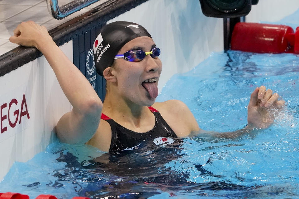 Yui Ohashi, of Japan, celebrates after winning the women's 200-meter individual medley final at the 2020 Summer Olympics, Wednesday, July 28, 2021, in Tokyo, Japan. (AP Photo/Charlie Riedel)