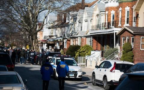 Police block off the street in the Brooklyn borough of New York where officials say Akayed Ullah was living - Credit: AP