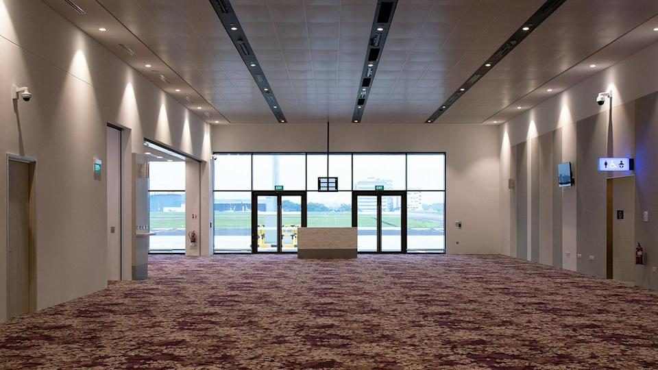 <p>Departing passengers will pass through these doors at the new Seletar Airport passenger terminal to get to their flights. (PHOTO: Yahoo News Singapore / Dhany Osman) </p>