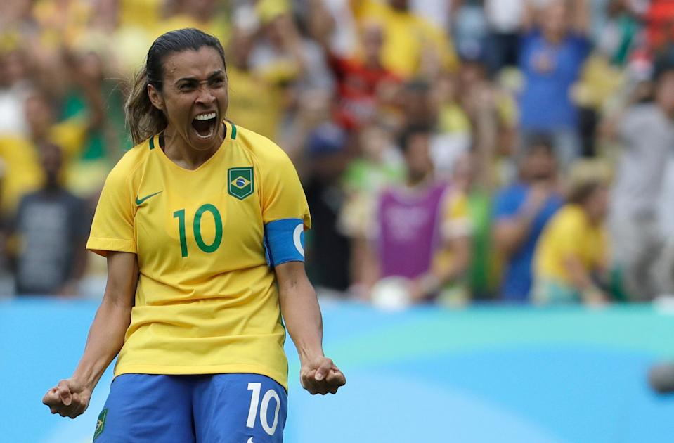 Brazil's Marta celebrates after scoring during the penalty shoot-out during a semi-final match of the women's Olympic football tournament between Brazil and Sweden at the Maracana stadium in Rio de Janeiro Tuesday Aug. 16, 2016.(AP Photo/Natacha Pisarenko)