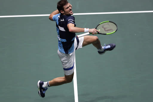 Argentina's tennis player Guido Pella celebrates after his victory over Pablo Carreno during their Davis Cup quarterfinal match in Madrid, Spain, Friday, Nov. 22, 2019. (AP Photo/Manu Fernandez)