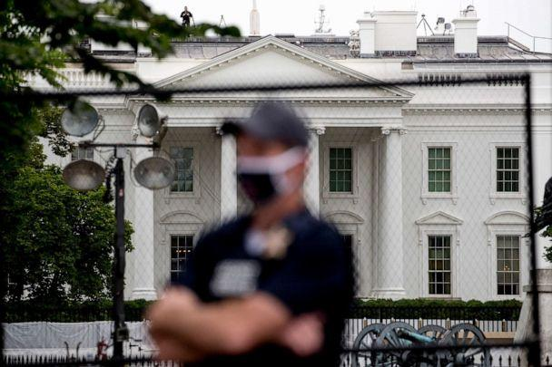 PHOTO: The White House is visible behind a large security fence as a uniformed Secret Service agent stands on the street in front of Lafayette Park in the morning hours in Washington, June 2, 2020, as protests continue over the death of George Floyd. (Andrew Harnik/AP)