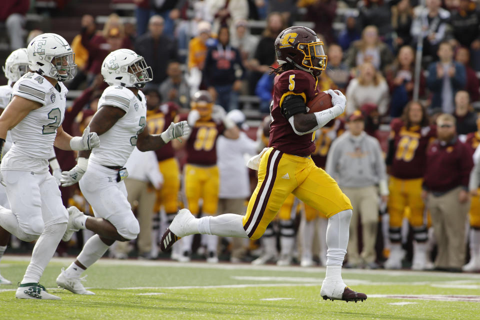 Central Michigan's Jonathan Ward, right, breaks away from Eastern Michigan's Brody Hoying, left, and Vince Calhoun for a 64-yard touchdown on a pass reception during the second quarter of an NCAA football game Saturday, Oct. 5, 2019 in Mount Pleasant, Mich. Central Michigan won 42-16. (AP Photo/Al Goldis)