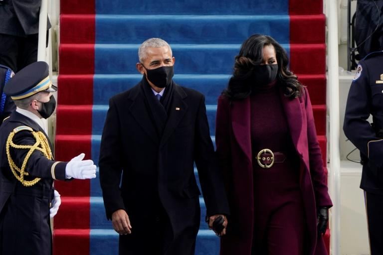 Former US President Barack Obama (L) and former US First Lady Michelle Obama (R) arrives for the inauguration of Joe Biden as the 46th US President on January 20, 2021