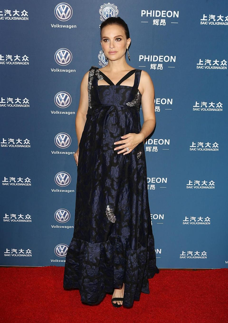 <p>The actress chose a navy blue brocade Erdem dress for an awards event in LA in mid-December. The full-length gown skimmed the star's bump and featured embellishments and a cross-bodice design. [Photo: Getty] </p>