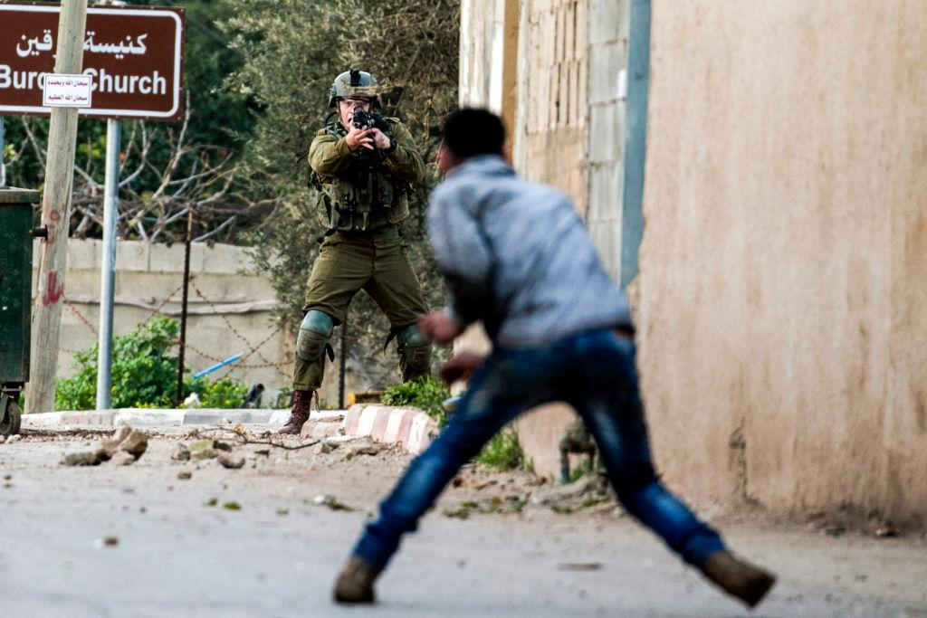 <p>A Palestinian protester confronts an Israeli soldier during an army search operation in the Palestinian village of Burqin in the northern occupied West Bank, on Feb. 3, 2018. Photo from AFP/Aafar Ashtiyeh/Getty Images. </p>