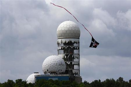 A kite flies near antennas of Former National Security Agency (NSA) listening station at the Teufelsberg hill (German for Devil's Mountain) in Berlin